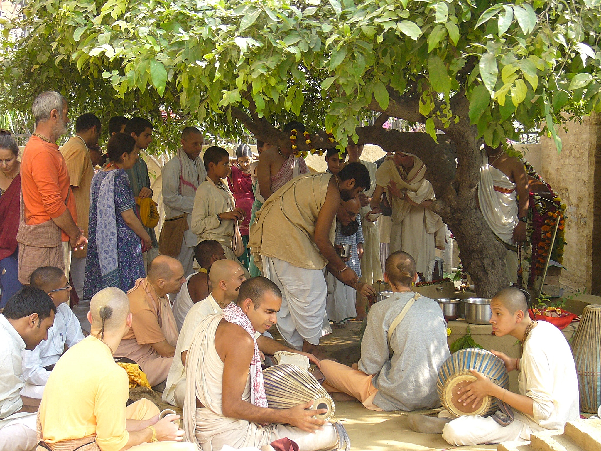 Devotees at a courtyard festival