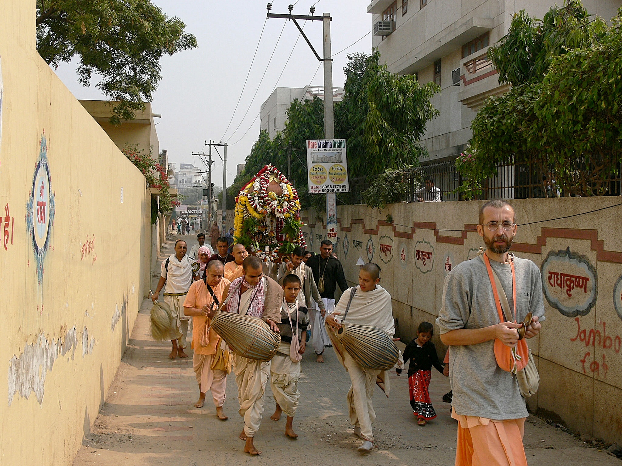 Radha Madhava carried to a courtyard festival
